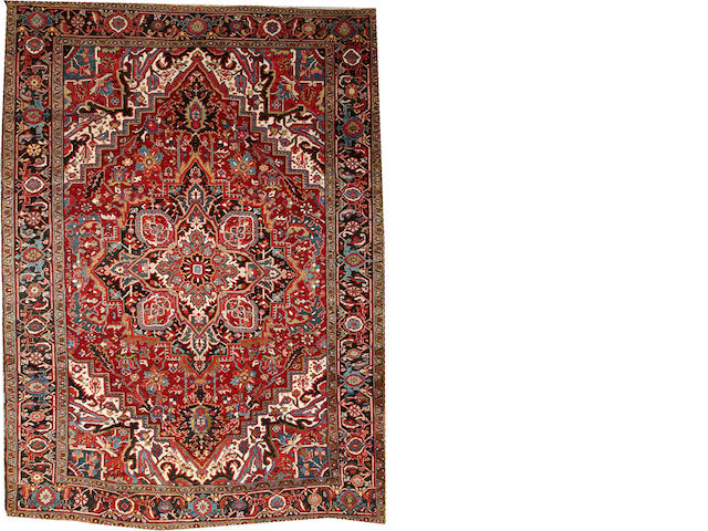 A Heriz carpet Northwest Persia size approximately 8ft. x 11ft.