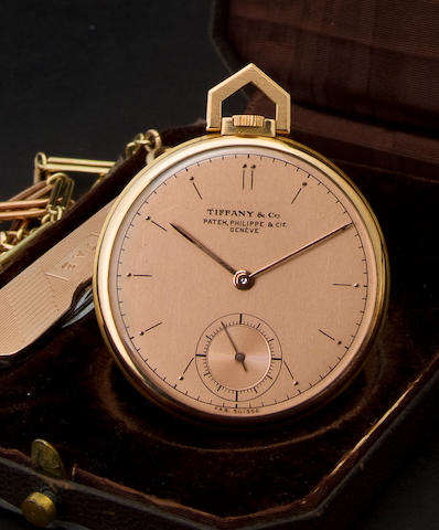 Patek Philippe & Cie. A fine 18K rose gold Art Deco dress watch with two color gold chain and rose gold pocket knifeRetailed by Tiffany & Co., Case no. 418225, Movement no. 890155, circa 1943