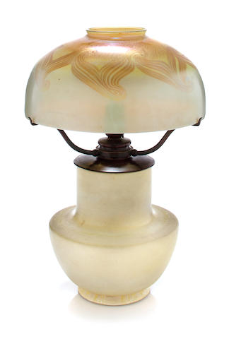A Tiffany Studios Favrile glass and pottery table lamp 1899-1918