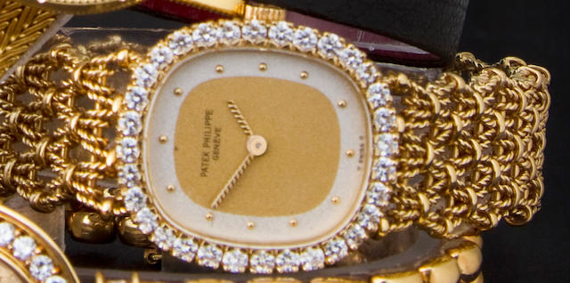 Patek Philippe. A fine 18K gold and diamond lady's bracelet watchRef:4134/9, Case no. 2813455, Movement no. 1410735
