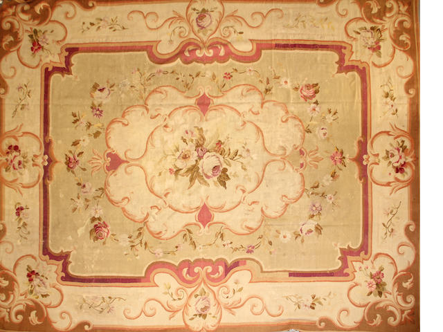 An Aubusson carpet size approximately 10ft. 6in. x 13ft. 4in.
