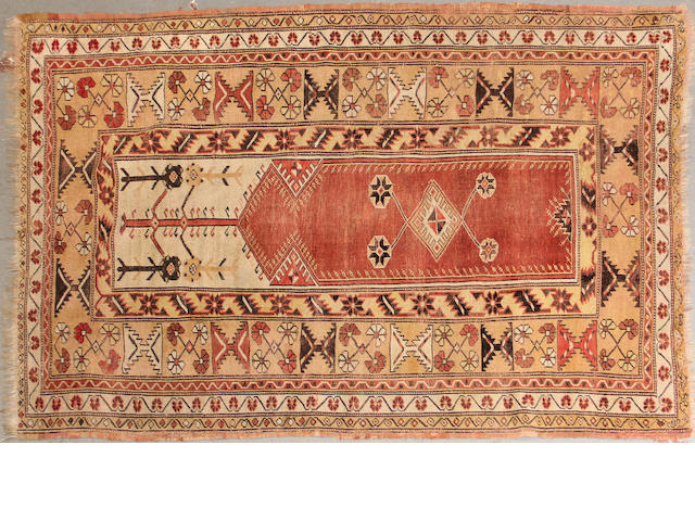 A Turkish rug size approximately 4ft. 2in. x 6ft. 3in.