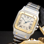 Cartier. A stainless steel and 18K gold bracelet watch with sweep seconds and dateSantos, No. 187901/29527