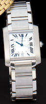 Cartier. A stainless steel automatic Tank wristwatch with center seconds, date and braceletTank Française, no. 902656CD
