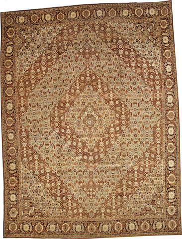 A Tabriz carpet Northwest Persia size approximately 13ft. 3in. x 10ft. 1in.