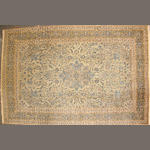A Kashan carpet  size approximately 8ft. 11in. x 13ft. 11in.