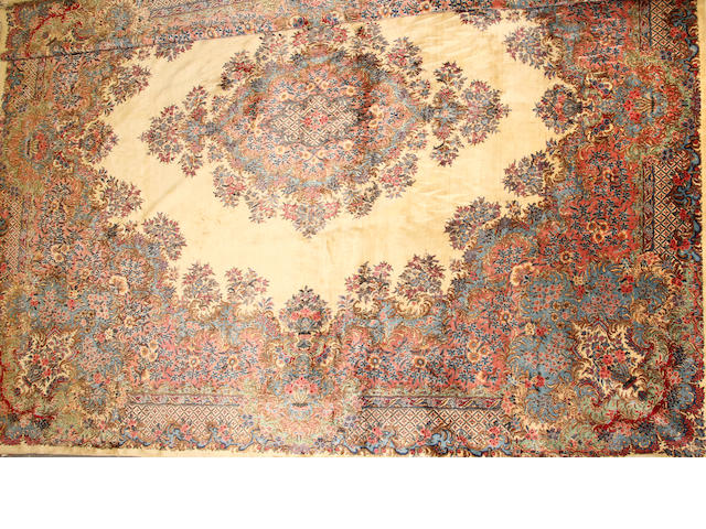 A Kerman carpet  size approximately 12ft. 7in. x 15ft. 1in.