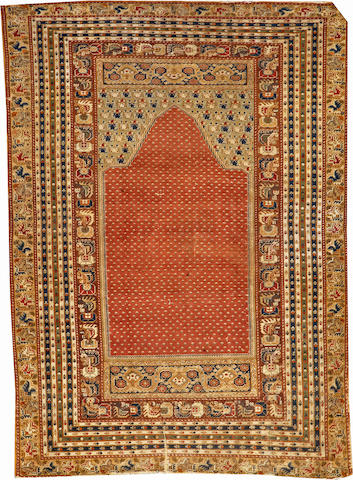 A Turkish rug Turkey size approximately 3ft. 10in. x 5ft. 4in.