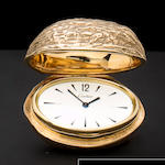 Cartier. A rare 9K gold purse watch in the form of a walnutCase No. 6924, Movement No. 1483566, case hallmarked London, 1968