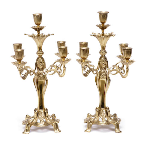 A pair of Art Nouveau style brass five light candelabra