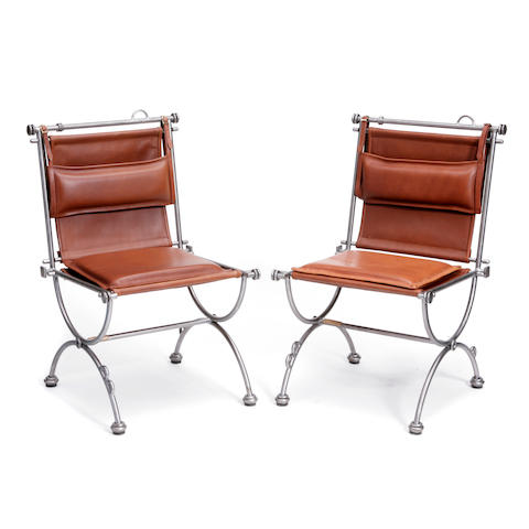 A pair of Ilana Goor iron and leather armchairs