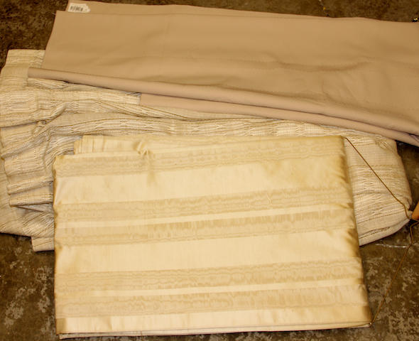 An assembled group of drapery panels and tablecloths
