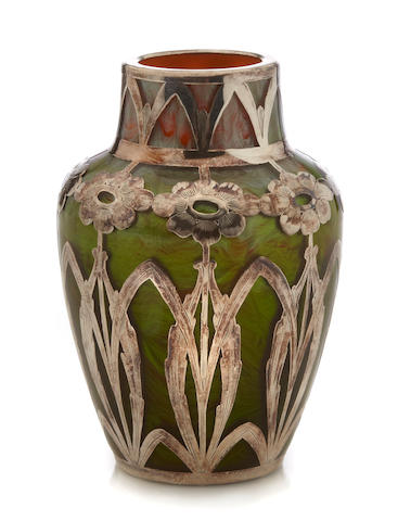 A small silver-overlaid Loetz iridescent paperweight glass vase circa 1900