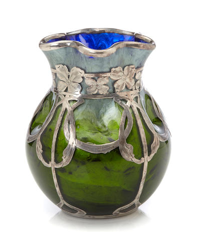 A silver-overlaid unsigned Loetz iridescent paperweight glass vase circa 1900