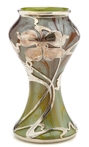 A silver-overlaid Loetz iridescent paperweight glass vase circa 1900