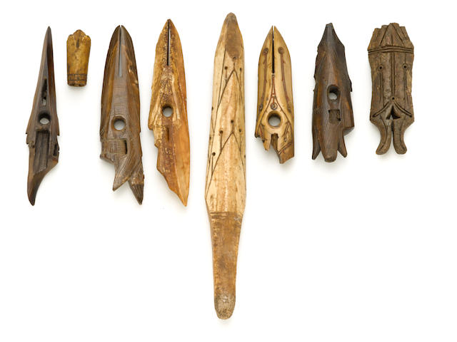 Eight ancient Eskimo ivory hunting implements
