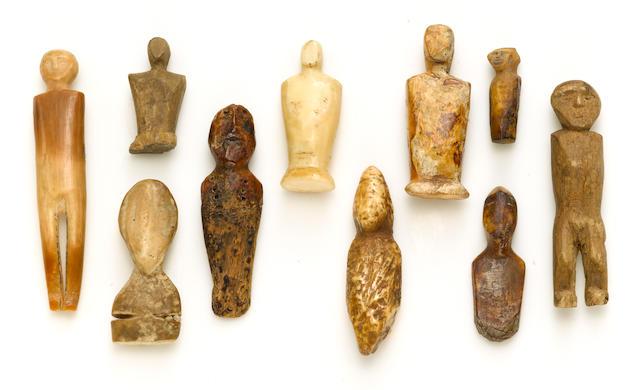 Ten Eskimo human effigies