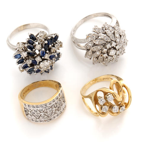 A group of four diamond, sapphire and gold cluster rings