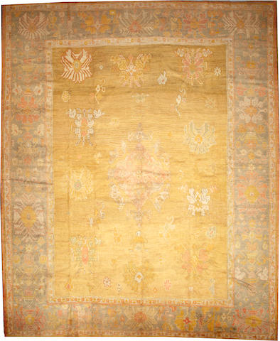 An Oushak carpet  West Anatolia size approximately 13ft. 6in. x 16ft. 6in.