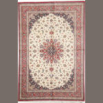 A Silk Qum size approximately 6ft. 6in. x 9ft. 8in.