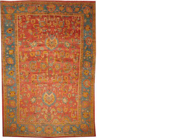 An Oushak carpet  West Anatolia size approximately 11ft. 6in. x 17ft.