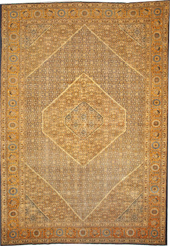 A Tabriz carpet  Northwest Persia size approximately 11ft. 2in. x 16ft.
