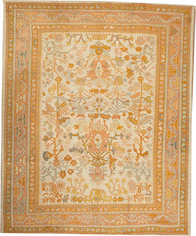 An Oushak carpet  West Anatolia size approximately 9ft. 8in. x 11ft. 10in.