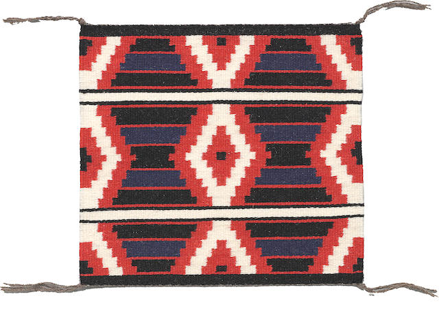 A Navajo tapestry weave miniature rug