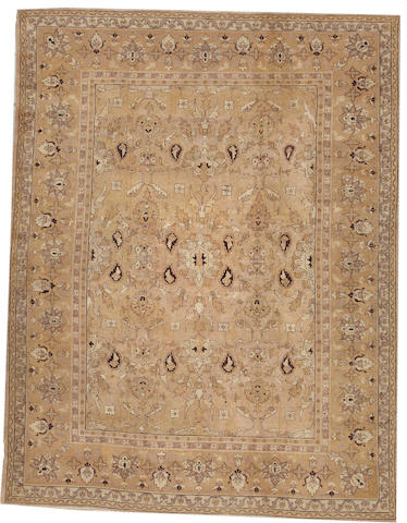 An Agra carpet  India size approximately 8ft. 10in. x 11ft. 5in.