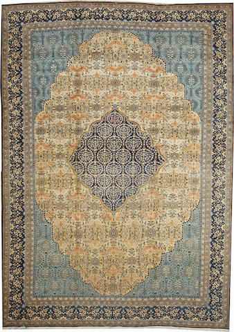 A Qum carpet with silk highlights  Central Persia size approximately 10ft. x 13ft. 10in.