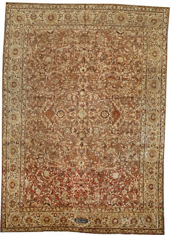 A Tabriz carpet  Northwest Persia size approximately 9ft. 4in. x 13ft.