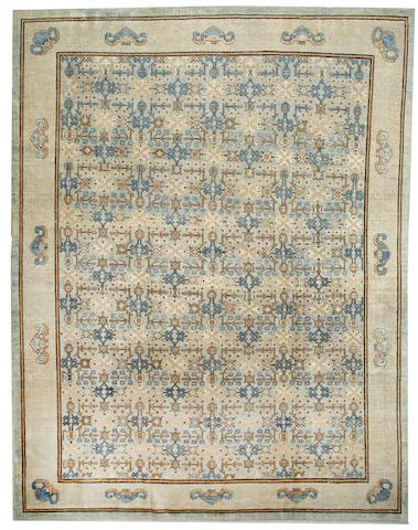 A Khotan carpet Turkestan size approximately 11ft. 8in. x 15ft.