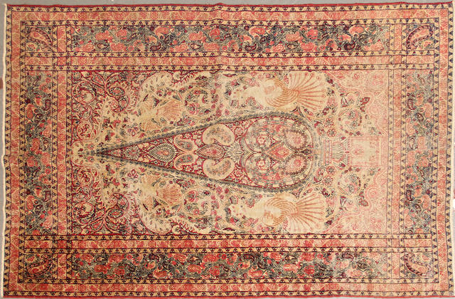 A Lavar Kerman rug size approximately 4ft. 6in. x 6ft. 11in.