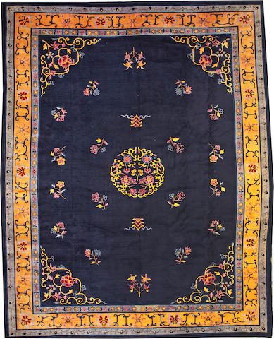 A Chinese carpet  China  size approximately 12ft. 4in. x 15ft. 9in.