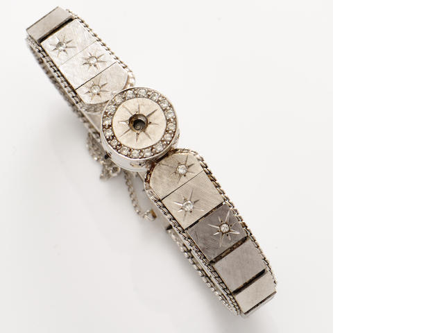 A diamond and 14k white gold wristwatch