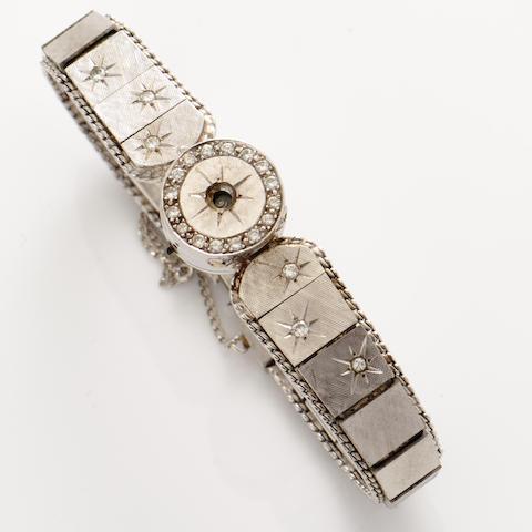 A diamond and 14k white gold wristwatch