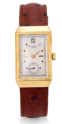 Patek Philippe. A fine 18K gold rectangular wristwatch with concealed lugsCase no. 614135, Movement no, 830964, circa 1935