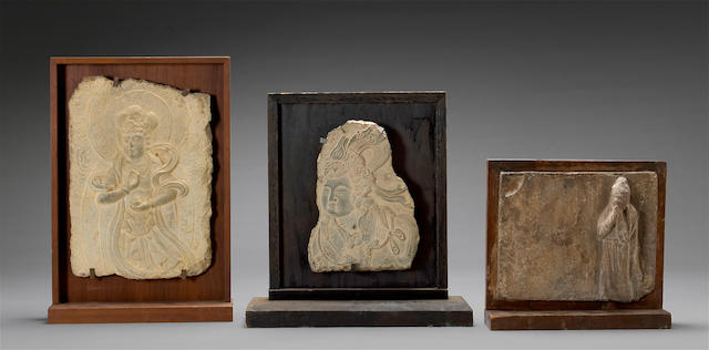 A group of three archaistic carved stone relief fragments