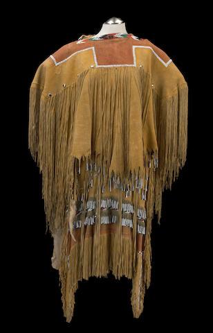 An Apache beaded puberty dress