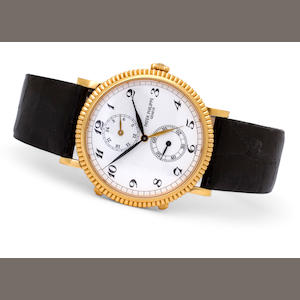 Patek Philippe. A fine 18K gold dual time zone travel wristwatchRef:5034
