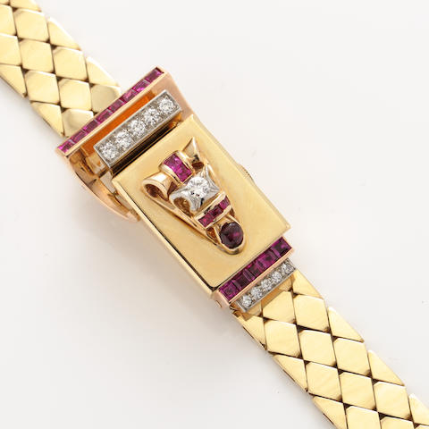 A diamond, ruby and 14k gold covered dial bracelet wristwatch