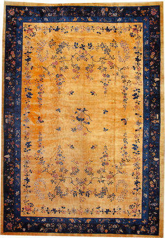 A Chinese carpet  China  size approximately 12ft. 2in. x 17ft. 4in.