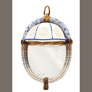 A rare Sèvres parcel-gilt porcelain and bronze applique, designed by Henri Rapin, executed by Jean-Baptiste Gauvenet and Leon-Charles Pêluche  1923