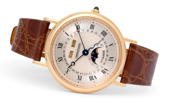 Breguet. A fine 18K rose gold automatic calendar wristwatch with moon Ref: 3040, No. 2853, 1990's