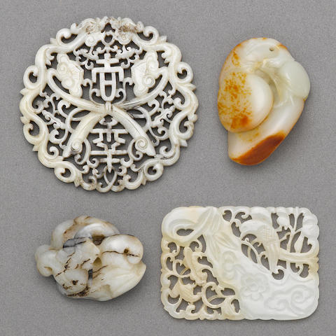 A group of four small jade carvings