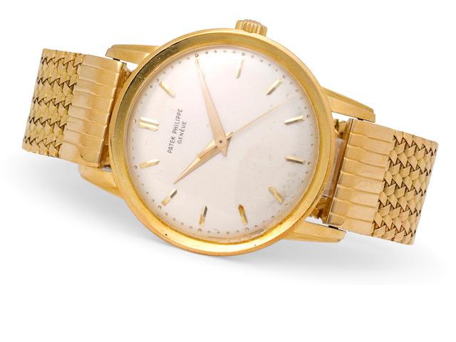 Patek Philippe. A fine 18K gold center seconds wristwatch with braceletRef:2481, Case No. 2607779, Movement No. 707651, circa 1959