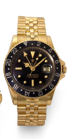 Rolex. A fine 18K gold automatic dual time zone center seconds wristwatch with date and braceletGMT-Master, Ref: 1675, Case no. 5231521, circa 1977
