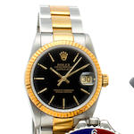 Rolex. A fine stainless steel and rose gold automatic center seconds wristwatch with braceletOyster Perpetual Datejust, Ref:68273, Case no. L484206, circa 1990