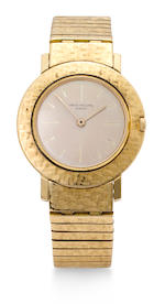 Patek Philippe. An 18K gold lady's wristwatch with bracelet by Gay frèresRef:2594/7, Case No.2629527, Movement No.791860, 1960's