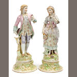 A pair of Continental porcelain figures in the Rococo taste